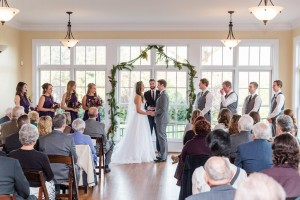 Romantic indoor wedding ceremony in the Rand-Bryan House sunroom