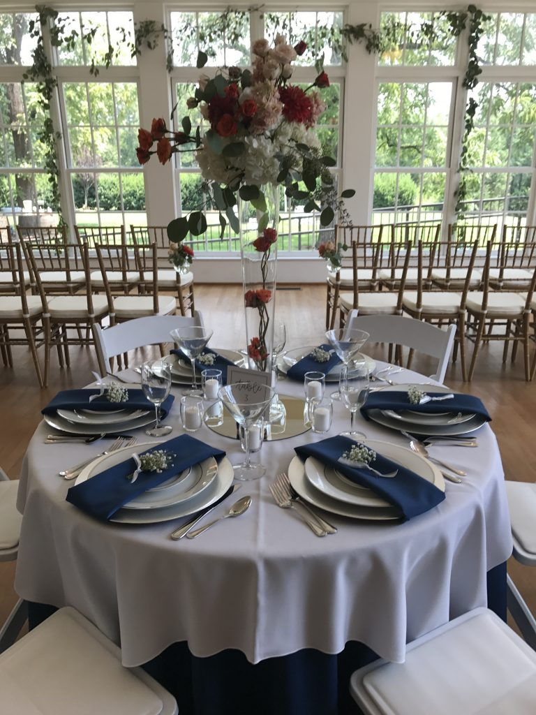 wedding package place settings with cobalt napkins and ivory chargers
