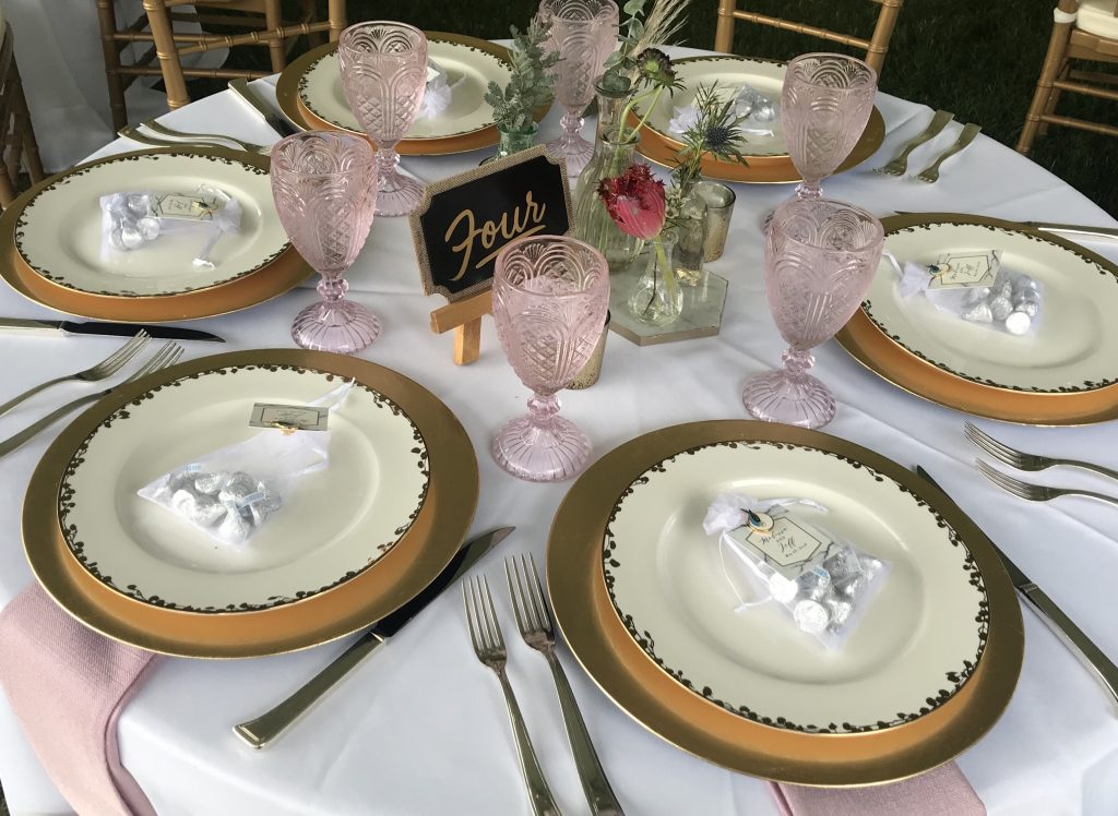 wedding package place setting with gold chargers and rose goblets