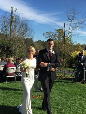 Another happy couple makes their way down the aisle after a beautiful outdoor wedding ceremony