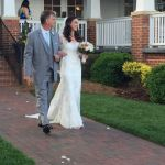 Bridal entrance for outdoor ceremony at Rand-Bryan House